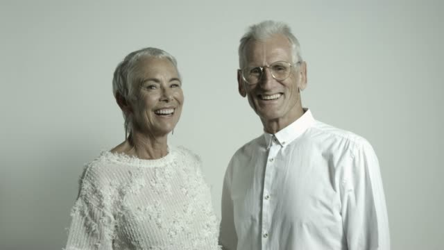 portrait of smiling retired senior couple - fashion stock videos & royalty-free footage