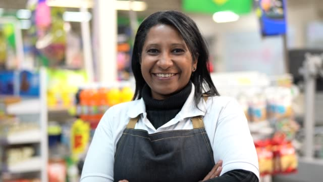 portrait of smiling seller of a supermarket - supermarket stock videos & royalty-free footage
