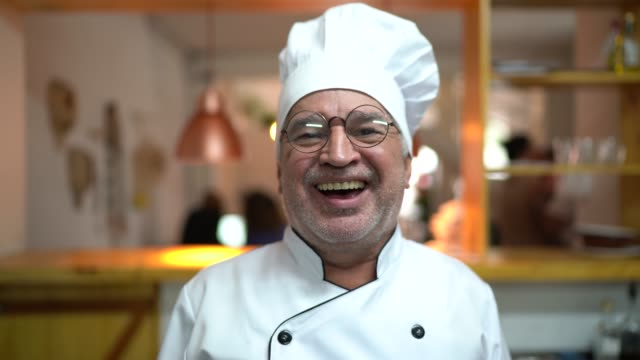 portrait of smiling senior chef in a kitchen - chief leader stock videos & royalty-free footage