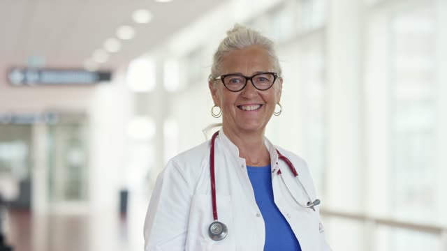 portrait of smiling senior healthcare worker - general practitioner stock videos & royalty-free footage
