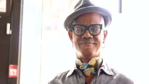 ms portrait of smiling senior man shopping in clothing boutique - attityd bildbanksvideor och videomaterial från bakom kulisserna
