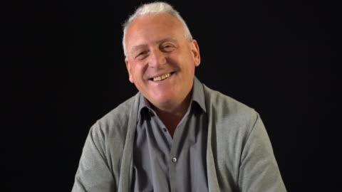 portrait of smiling senior man - one senior man only stock videos & royalty-free footage