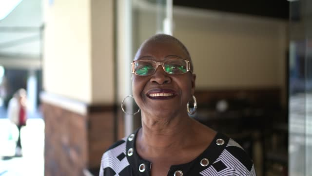 portrait of smiling senior woman at city street - pardo brazilian stock videos & royalty-free footage