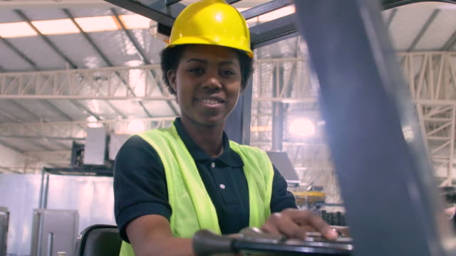portrait of smiling warehouse worker in forklift - uniform stock videos & royalty-free footage