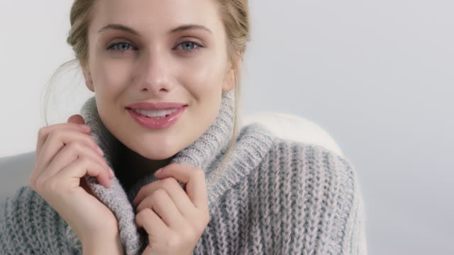 portrait of smiling woman feeling cozy in sweater - turtleneck stock videos & royalty-free footage