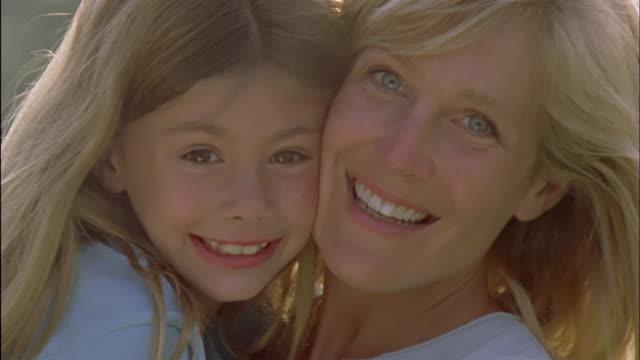 CU, Portrait of smiling woman with daughter (6-7), Chateau du Parc, Saint Ferme, France