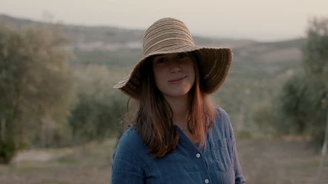 portrait of smiling woman with straw hat in nature - orchard stock videos & royalty-free footage
