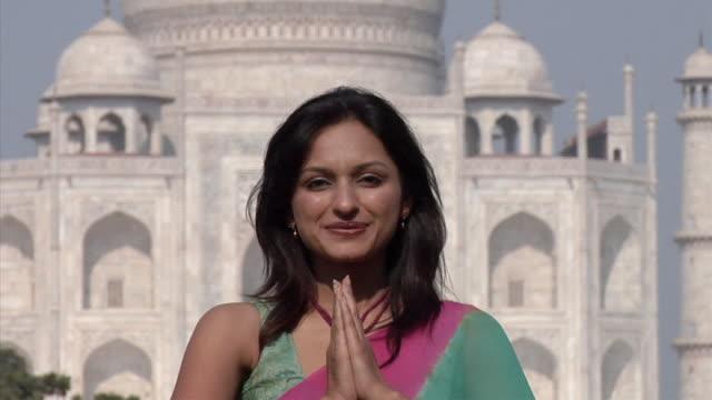 SLO MO, ZO, MS, Portrait of smiling woman with Taj Mahal in background, Agra, Uttar Pradesh, India