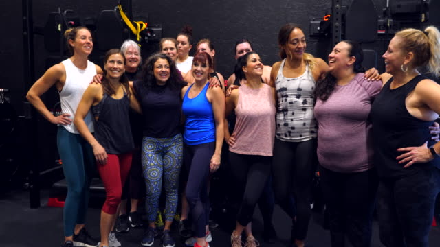 ms portrait of smiling womens fitness class after workout in gym - teamwork stock videos & royalty-free footage