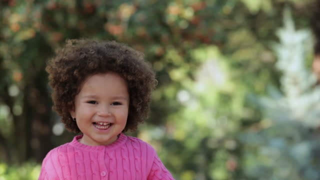 MS TU Portrait of smiling young girl outdoors / Richmond, Virginia, United States