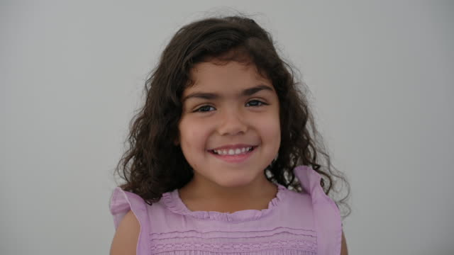 portrait of smiling young hispanic girl - sleeveless top stock videos & royalty-free footage