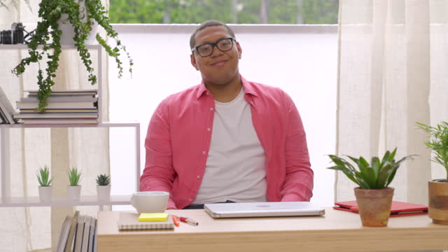 portrait of smiling young man in office - one young man only stock videos & royalty-free footage