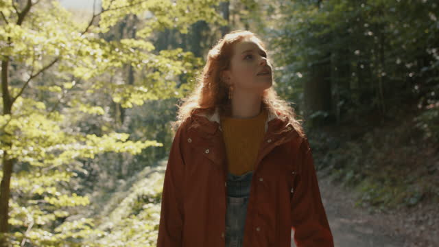 portrait of smiling young woman in forest - wonderlust stock videos & royalty-free footage