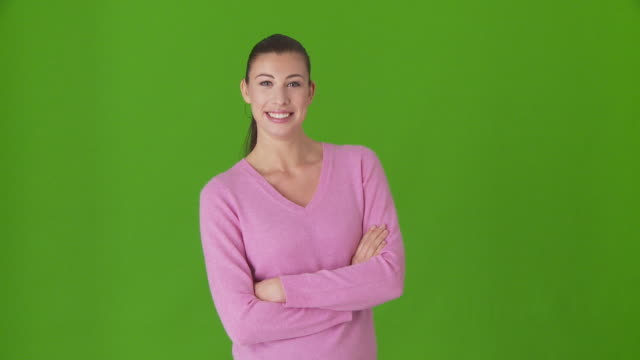 portrait of smiling young woman's standing - pferdeschwanz stock-videos und b-roll-filmmaterial
