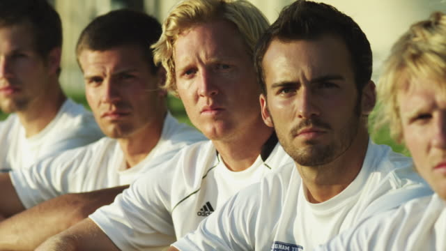 cu pan portrait of soccer players sitting side by side on lawn / provo, utah, usa - side by side stock videos & royalty-free footage