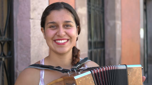 portrait of street musician with accordion - mexican ethnicity stock videos & royalty-free footage