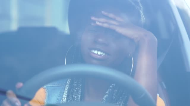 portrait of stressed african woman in car - traffic jam stock videos & royalty-free footage