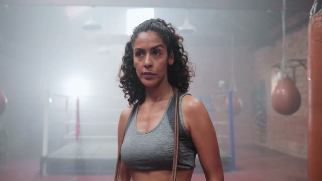 portrait of strong mixed race female in boxing gym - strength stock videos & royalty-free footage