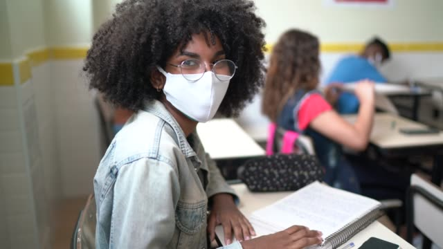 portrait of student in classroom wearing face mask - female high school student stock videos & royalty-free footage