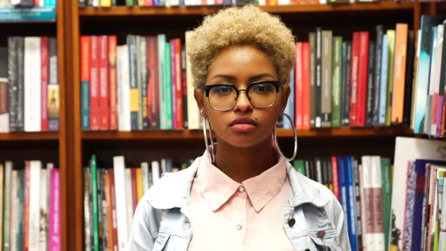 portrait of student on library - african american ethnicity stock videos & royalty-free footage