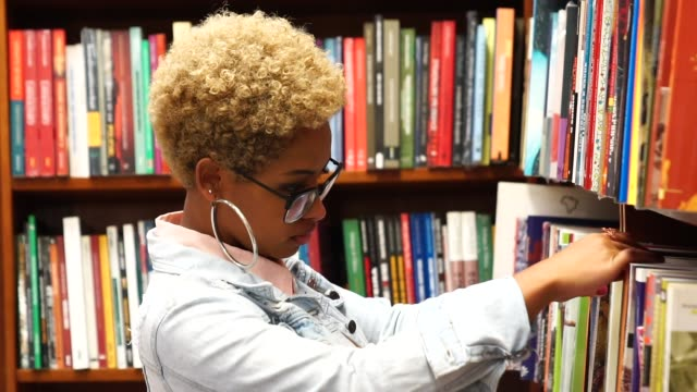 portrait of student on library - bookshelf stock videos & royalty-free footage