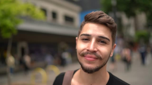 portrait of student young man on the street - adult stock videos & royalty-free footage