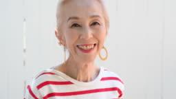 Portrait of stylish senior Asian woman smiling