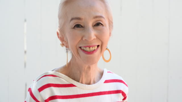 portrait of stylish senior asian woman smiling - fashionable stock videos & royalty-free footage