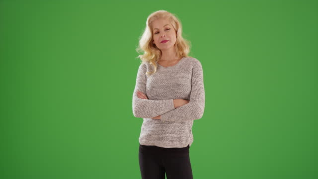 portrait of successful caucasian woman smiling at camera on green screen - blonde hair stock videos & royalty-free footage
