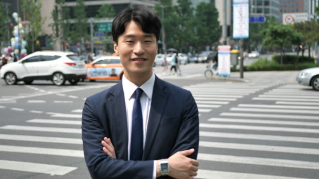 portrait of successful korean businessman with arms crossed - korean ethnicity stock videos & royalty-free footage