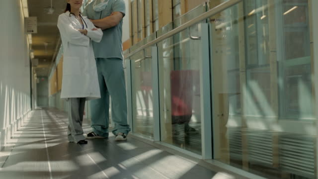 ws tu portrait of surgeon and female doctor in hospital hallway / vancouver, british columbia, canada - diminishing perspective stock videos & royalty-free footage