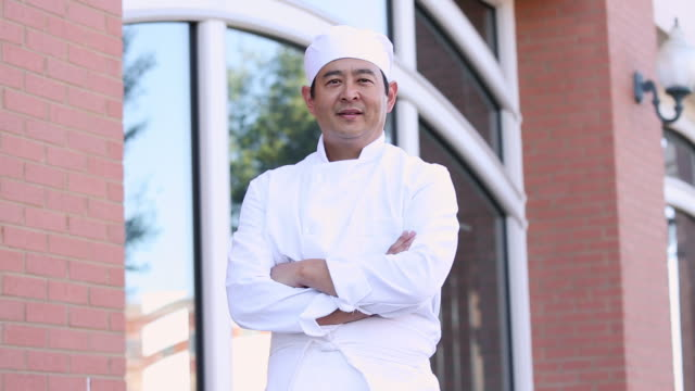 ms pan portrait of sushi chef in front of restaurant / richmond, virginia, usa - in front of stock videos & royalty-free footage