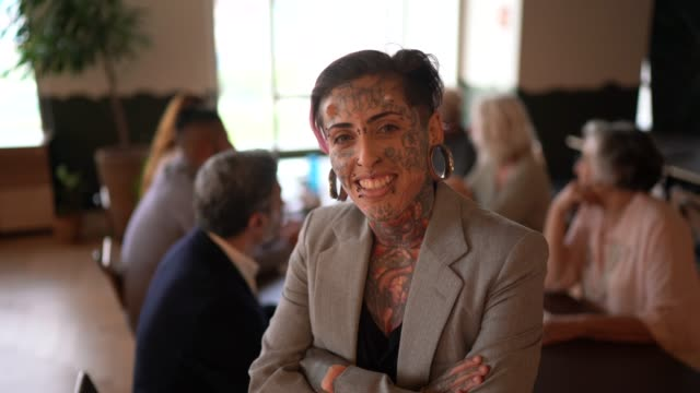 portrait of tattooed businesswoman at modern office - equality stock videos & royalty-free footage