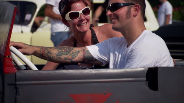 ms, portrait of tattooed couple sitting in convertible car, jacksonville, florida, usa - see other clips from this shoot 1403 stock videos and b-roll footage