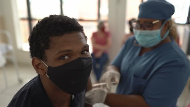 portrait of teenager boy being vaccinated - wearing face mask - looking at camera stock videos & royalty-free footage