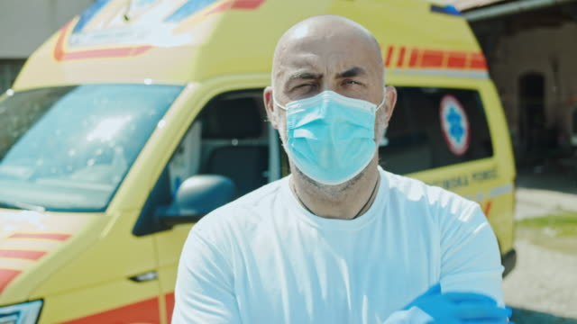 slo mo portrait of the ambulance driver wearing a medical mask - paramedic stock videos & royalty-free footage