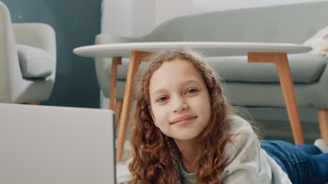 portrait of the little girl using laptop - curly stock videos & royalty-free footage