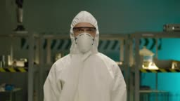 Portrait of the Professional Scientist . In the background of modern laboratory . Portrait of a young man chemist or doctor with medical protective coverall . Shot on ARRI ALEXA Cinema Camera