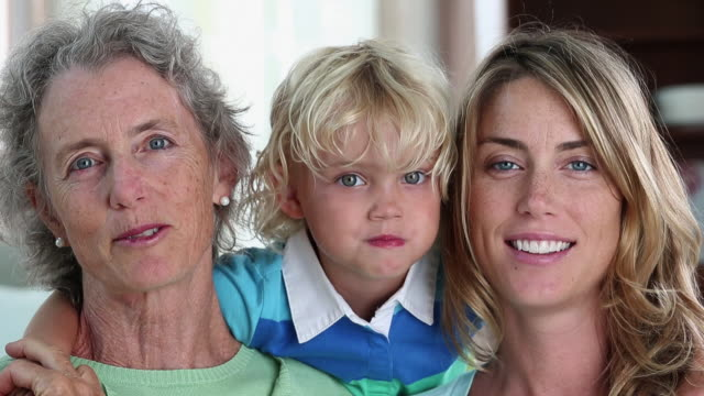 cu portrait of three generations of women smiling at camera / richmond, virginia, united states - drei personen stock-videos und b-roll-filmmaterial