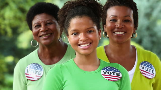 ms pan portrait of three generations of women wearing vote buttons / richmond, virginia, usa - decisions stock videos & royalty-free footage