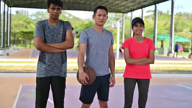portrait of three multi-ethnic young asian basketball players - 20 29 years stock videos & royalty-free footage