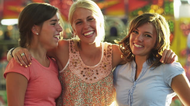 ms tu portrait of three teenage girls (16-17) in amusement park / american fork city, utah, usa - amicizia tra donne video stock e b–roll