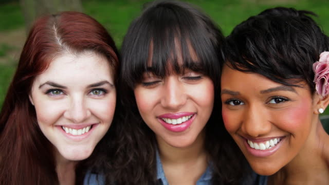 CU Portrait of three young women / NYC, New York, United States