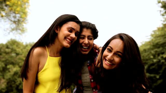 Portrait of three young women smiling, Delhi, India