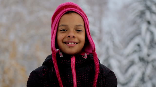 portrait of too cute 7 years old girl on the snow landscape - ethnicity stock videos & royalty-free footage