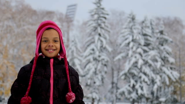 portrait of too cute 7 years old girl on the snow landscape - cold temperature stock videos & royalty-free footage