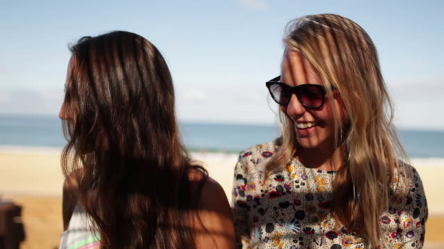 portrait of two beautiful woman smiling at the camera by the beach in the south of france. - shadow stock videos & royalty-free footage