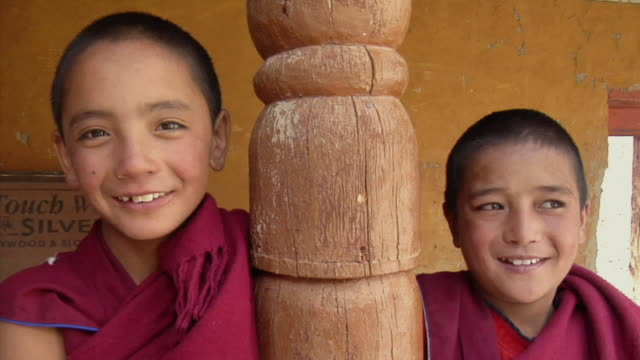 cu, portrait of two boys (12-13) at likir monastery, ladakh, jammu and kashmir, india - zen like stock videos & royalty-free footage
