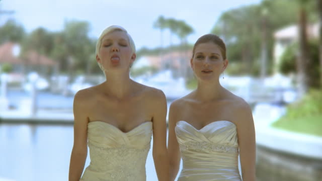 ms portrait of two brides holding hands and making faces, jacksonville, florida, usa - homosexuell stock-videos und b-roll-filmmaterial