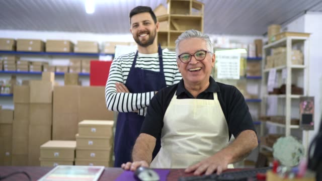 portrait of two coworkers together inside a craft equipment store - family business - small business stock videos & royalty-free footage